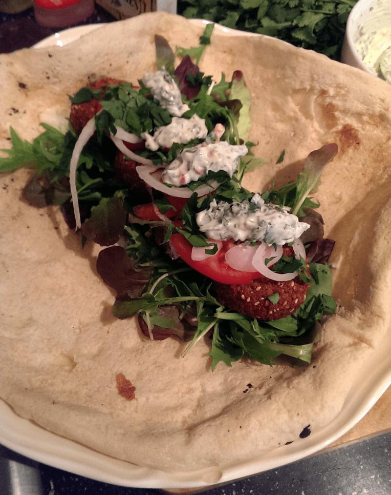 An open falafel wrap