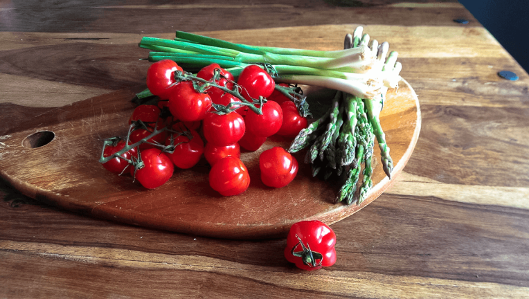 cherry tomatoes with asparagus and spring onions for frittata